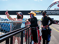 Jul 11, 2020; Clermont, Indiana, USA; NHRA top fuel driver Steve Torrence (center) and Antron Brown (right) take a selfie with a fan during qualifying for the E3 Spark Plugs Nationals at Lucas Oil Raceway. This is the first race back for NHRA since the start of the COVID-19 global pandemic. Mandatory Credit: Mark J. Rebilas-USA TODAY Sports