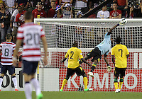 COLUMBUS, OHIO - SEPTEMBER 11, 2012:  Clint Dempsey (8) and Geoff Cameron (21) of the USA MNT watch Dwayne Miller (13) of  Jamaica make a save during a CONCACAF 2014 World Cup qualifying  match at Crew Stadium, in Columbus, Ohio on September 11. USA won 1-0.