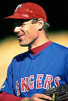 John Wetteland of the Texas Rangers during a game at Dodger Stadium in Los Angeles, California during the 1997 season.(Larry Goren/Four Seam Images)