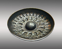 250 - 150 B.C Etruscan phiale or patera, or wine drinking bowl, produced in Calena, inv 4566,  National Archaeological Museum Florence, Italy , against grey