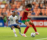 HOUSTON, TX - JUNE 10: Crystal Dunn #19 of the USWNT defends Jessica Silva #10 of Portugal during a game between Portugal and USWNT at BBVA Stadium on June 10, 2021 in Houston, Texas.