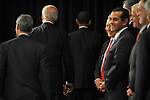 President Elect Barack Obama leaves the first press conference of his transition team with Vice-President Elect Joseph Biden (left) and Chief of Staff Rahm Emanuel (far left) behind him as his economic advisers watch at the Hilton Hotel in downtown Chicago, Illinois on November 7, 2008.