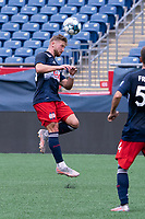 FOXBOROUGH, MA - JULY 4: Pierre Cacet #44 of the New England Revolution II heads a high ball during a game between Greenville Triumph SC and New England Revolution II at Gillette Stadium on July 4, 2021 in Foxborough, Massachusetts.