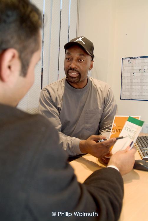 A client receives employment advice at Harrow Road Citizens Advice Bureau, West London.