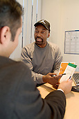 A client receives employment advice at Harrow Road Citizens Advice Bureau, West London.