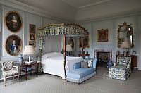 The late Dutchess of Beaufort's bedroom, painted in a palette of pale blue and white with matching floral upholstery by Colefax and Fowler