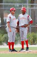 July 14, 2009:  Manager Pat Kelly talks with Yorman Rodriguez of the GCL Reds during a game at Boston Red Sox Training Complex in Fort Myers, FL.  The GCL Reds are the Gulf Coast Rookie League affiliate of the Cincinnati Reds.  Photo By Mike Janes/Four Seam Images