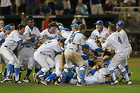 UCLA Bruins dog pile at the end of the 2013 Men's College World Series Final on June 25, 2013 at TD Ameritrade Park in Omaha, Nebraska. The Bruins defeated the Bulldogs 8-0, winning the National Championship. (Andrew Woolley/Four Seam Images)