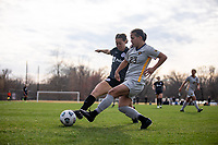 LOUISVILLE, KY - MARCH 13: Chinyelu Asher #43 of Racing Louisville FC and Abby Rodriguez #23 of West Virginia University fight for the ball during a game between West Virginia University and Racing Louisville FC at Thurman Hutchins Park on March 13, 2021 in Louisville, Kentucky.