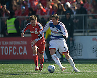 11 April 2009: Toronto FC defender Jim Brennan # 11 and FC Dallas forward Kenny Cooper #33 during MLS action at BMO Field Toronto in a game between FC Dallas and Toronto FC. .Final score was a 1-1 draw.