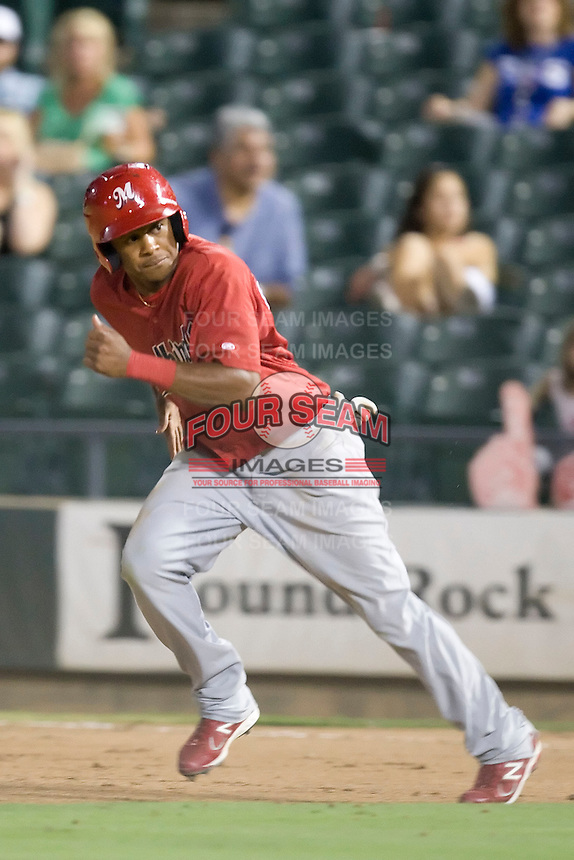 Memphis Redbirds outfielder Adron Chambers #4 attempts to steal during a game against the Round Rock Express at the Dell Diamond on July 7, 2011in Round Rock, Texas.  Round Rock defeated Memphis 6-4.  (Andrew Woolley / Four Seam Images)
