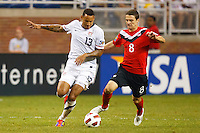 7 June 2011: USA Men's National Team midfielder Jermaine Jones (13) and Canada midfielder Will Johnson (8) go for the ball during the CONCACAF soccer match between USA MNT and Canada MNT at Ford Field Detroit, Michigan. USA won 2-0.