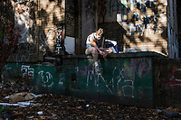"""A woman who goes by the name """"Samantha"""" shooting heroin at the back of an abandoned house. Drugs are one of the biggest problems in Detroit, Michigan, with a direct correlation to the city's high crime rate."""
