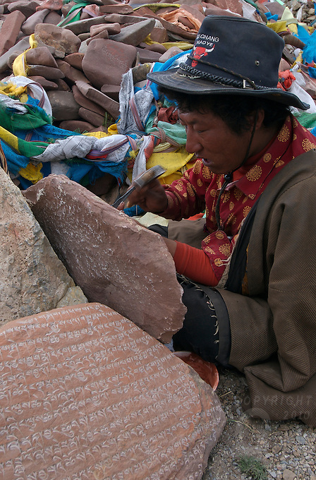 """Carving traditional prayer stones at Namtso Lake :Namtso, another holy lake in Tibet, is located near Damxung. 4718 meters (15475 feet) above sea level and covering 1900 square kilometers (735 square miles), the lake is the highest saltwater lake in the world and the second largest saltwater lake in China. The snow capped Mt. Nyainqentanglha, considered as the son of Namtso and leader of sacred mountains, soars up to sky beside her. Singing streams converge into the clean sapphire blue lake, which looks like a huge mirror framed and dotted with flowers..The Namtso Lake is held as """"the heavenly lake"""" or """"the holy lake"""" in northern Tibet. .Respected as one of the three holiest lakes in Tibet, the Namtso Lake is the seat of Paramasukha Chakrasamvara for Buddhist pilgrims. In the fifth and sixth month of the Tibetan calendar each year, many Buddhists come to the lake pay homage and pray. Deep tracks are worn into the lakeshore due to this activity. In history, monasteries stood like trees in a forest around the site, attracting large numbers of pilgrims as eminent monks in Buddhist temples extended Buddhist teachings...Buddhists believe Buddhas, Bodhisattvas and Vajras will assemble to hold religious meeting at Namtso in the year of sheep on Tibetan calendar. It is said that walking around the lake at the right moment is 100,000 times more efficacious than that in normal years. That's why thousands of pilgrims from every corner of the world come to pray at the site, with the activity reaching a climax on Tibetan April 15...Walking around the lake takes a week. Ritual walkers love to burn aromatic plants to raise smoke on Auspicious Island [explain this a little] and throw a piece of hada scarf into the lake as a token of fulfilled wishes. If the scarf sinks, it implies ones wish is accepted by the Buddha; if the scarf flows on the water or only half sinks, it means one has failed to be honest and something unhappy may lie ahead...On the four sides of the lake stand four"""