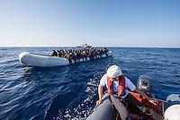 Sea Watch-2.<br /> Die Sea Watch-2 bei ihrer 13. SAR-Mission vor der libyschen Kueste.<br /> Im Bild: Ein Schlauchboot mit ca. 160 Menschen. Im Hintergrund die Sea Watch-2.<br /> 20.10.2016, Mediterranean Sea<br /> Copyright: Christian-Ditsch.de<br /> [Inhaltsveraendernde Manipulation des Fotos nur nach ausdruecklicher Genehmigung des Fotografen. Vereinbarungen ueber Abtretung von Persoenlichkeitsrechten/Model Release der abgebildeten Person/Personen liegen nicht vor. NO MODEL RELEASE! Nur fuer Redaktionelle Zwecke. Don't publish without copyright Christian-Ditsch.de, Veroeffentlichung nur mit Fotografennennung, sowie gegen Honorar, MwSt. und Beleg. Konto: I N G - D i B a, IBAN DE58500105175400192269, BIC INGDDEFFXXX, Kontakt: post@christian-ditsch.de<br /> Bei der Bearbeitung der Dateiinformationen darf die Urheberkennzeichnung in den EXIF- und  IPTC-Daten nicht entfernt werden, diese sind in digitalen Medien nach §95c UrhG rechtlich geschuetzt. Der Urhebervermerk wird gemaess §13 UrhG verlangt.]