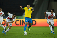 5th July 2021; Nilton Santos Stadium, Rio de Janeiro, Brazil; Copa America, Brazil versus Peru; Casemiro of Brazil goes past Alexander Callens and Renato Tapia of Peru