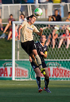 Christine Sinclair (12) of FC Gold Pride heads the ball in front of Cat Whitehill (4) of the Washington Freedom at the Maryland SoccerPlex in Boyds, Maryland. FC Gold Pride defeated the Washington Freedom, 4-1.