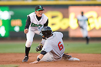 Shortstop Miguel Rojas #17 of the Dayton Dragons grimaces in pain after making the tag on Jaime Pedroza #6 of the Great Lakes Loons at Fifth Third Field April 22, 2009 in Dayton, Ohio. (Photo by Brian Westerholt / Four Seam Images)