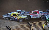 Dec. 10, 2011; Chandler, AZ, USA;  LOORRS pro 2 unlimited driver Rob Naughton (54), Rodrigo Ampudia (36) and Robby Woods (99) during round 15 at Firebird International Raceway. Mandatory Credit: Mark J. Rebilas-