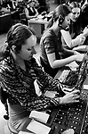 Telephone exchange call centre London Uk female young women office work woking shifts at a switchboard 1970s UK