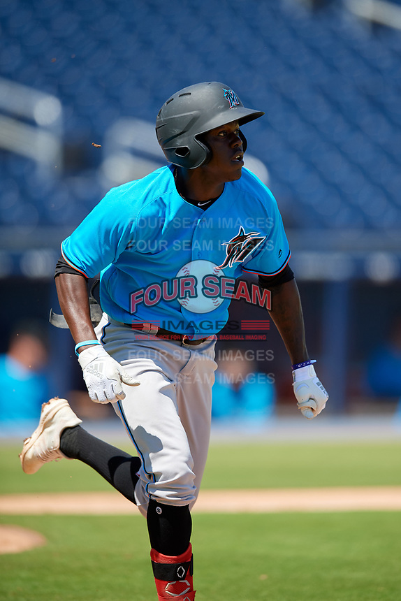 Miami Marlins Jazz Chisholm (1) runs to first base during an Instructional League game against the Washington Nationals on September 26, 2019 at FITTEAM Ballpark of The Palm Beaches in Palm Beach, Florida.  (Mike Janes/Four Seam Images)