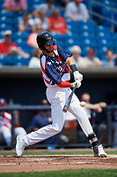 Quad Cities River Bandits shortstop David Hensley (15) hits a single during a game against the West Michigan Whitecaps on July 23, 2018 at Modern Woodmen Park in Davenport, Iowa.  Quad Cities defeated West Michigan 7-4.  (Mike Janes/Four Seam Images)