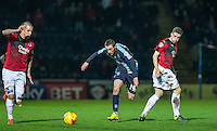 Michael Harriman of Wycombe Wanderers chases the ball under pressure during the Sky Bet League 2 match between Wycombe Wanderers and Crawley Town at Adams Park, High Wycombe, England on 28 December 2015. Photo by Andy Rowland / PRiME Media Images