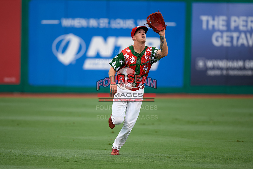 "Palm Beach Cardinals left fielder Shane Billings (22) settles under a fly ball during a game against the Charlotte Stone Crabs on July 22, 2017 at Roger Dean Stadium in Palm Beach, Florida.  The Cardinals wore special ""Ugly Sweater"" jerseys for Christmas in July.  Charlotte defeated Palm Beach 5-2.  (Mike Janes/Four Seam Images)"