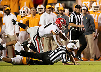 KNOXVILLE, TN - OCTOBER 5: Referee is knocked down during a play after a Tae Crowder fumble recovery during a game between University of Georgia Bulldogs and University of Tennessee Volunteers at Neyland Stadium on October 5, 2019 in Knoxville, Tennessee.