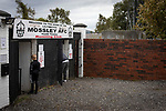 Mossley 4 Pickering Town 1, 26/09/2020. Seel Park, Northern Premier League Division One North West. Two spectators entering the ground via the turnstiles before Mossley take on Pickering Town. Formed in 1903, Mossley moved into their current ground in 1912 and have played there ever since. The home team won the match 4-1, watched by a crowd of 400, the maximum number permitted in the ground under COVID-19 social distancing regulations. Photo by Colin McPherson.