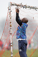 The Club 93 goalkeeper puts up the goal net prior to a Hackney & Leyton League match at Hackney Marshes - 01/03/09 - MANDATORY CREDIT: Gavin Ellis/TGSPHOTO - Self billing applies where appropriate - Tel: 0845 094 6026