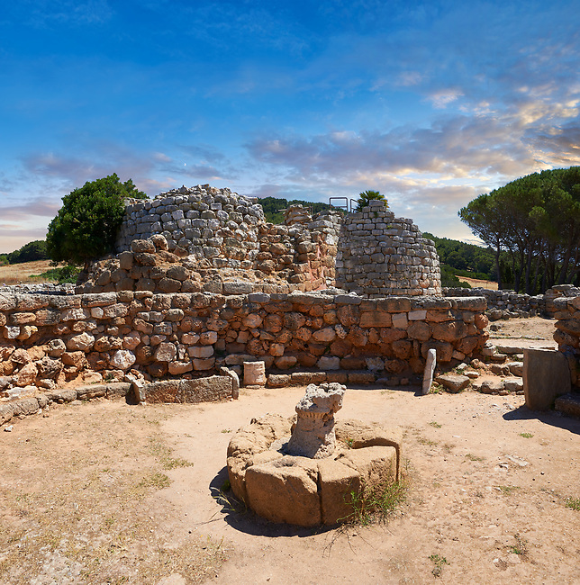 Pictures and image of the exterior ruins of Palmavera prehistoric Nuragic village meeting hall with Nuraghe tower behind,  archaeological site, middle Bronze age (1500 BC), Alghero, Sardinia.