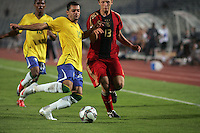Germany's Bjorn Kopplin (13) battles Brazil's Wellington Junior (15) during the FIFA Under 20 World Cup Quarter-final match at the Cairo International Stadium in Cairo, Egypt, on October 10, 2009. Germany lost 2-1 in overtime play.