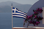 Greek Flag on a Pastel Building