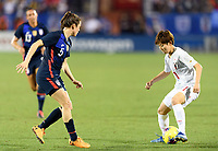 FRISCO, TX - MARCH 11: Kelley O'Hara #5 of the United States watches Riko Ueki #11 of Japan during a game between Japan and USWNT at Toyota Stadium on March 11, 2020 in Frisco, Texas.