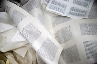 """Pages of Chinese-language Bibles sit in a trash container after their quality has been checked as they come off a press in the Amity Printing Company's new printing facility in Nanjing, China....On May 18, 2008, the Amity Printing Company in Nanjing, Jiangsu Province, China, inaugurated its new printing facility in southern Nanjing.  The facility doubles the printing capacity of the company, now up to 12 million Bibles produced in a year, making Amity Printing Company the largest producer of Bibles in the world.  The company, in cooperation with the international organization the United Bible Societies, produces Bibles for both domestic Chinese use and international distribution.  The company's Bibles are printed in Chinese and many other languages.  Within China, the Bibles are distributed both to registered and unregistered Christians who worship in illegal """"house churches."""""""