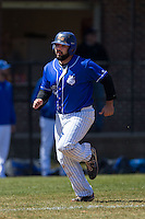 Mike Vigliarolo (42) of the Saint Louis Billikens scores a run in the first inning against the Davidson Wildcats at Wilson Field on March 28, 2015 in Davidson, North Carolina. (Brian Westerholt/Four Seam Images)