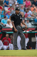 Home plate umpire Edwin Moscoso during the South Atlantic League game between the West Virginia Power and the Hickory Crawdads at L.P. Frans Stadium on August 15, 2015 in Hickory, North Carolina.  The Power defeated the Crawdads 9-0.  (Brian Westerholt/Four Seam Images)
