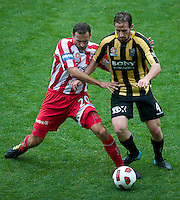MELBOURNE, AUSTRALIA - SEPTEMBER 19, 2010: Nick Ward from the Phoenix and Josip Skoko from the Heart compete for the ball in Round 7 of the 2010 A-League between the Melbourne Heart and Wellington Phoenix at AAMI Park on September 19, 2010 in Melbourne, Australia. (Photo by Sydney Low / Asterisk Images)