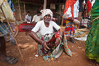 Maria Tribe cock fighter trainer in Tokapal market in Chhattisgarh India
