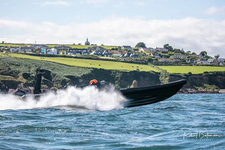 Royal Cork's John Ryan opens up the big black RIB in Cork Harbour during the record-breaking 1 hour 47 minutes and 7 seconds run to the Fastnet Rock and back