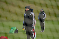 SWANSEA, WALES - JANUARY 28:  Garry Monk, Manager of Swansea City watches his players during training on January 28, 2015 in Swansea, Wales.