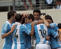 Argentina defender Federico Fernandez (17) celebrates his goal with teammates. In an international friendly (Clash of Titans), Argentina defeated Brazil, 4-3, at MetLife Stadium on June 9, 2012.