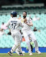 7th January 2021; Sydney Cricket Ground, Sydney, New South Wales, Australia; International Test Cricket, Third Test Day One, Australia versus India; Mohammed Siraj of India celebrates with Rishabh Pant of India the wicket of David Warner of Australia