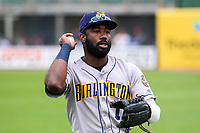 Burlington Bees outfielder Kevin Williams (11) warms up in the outfield prior to a Midwest League game against the Wisconsin Timber Rattlers on May 19, 2018 at Fox Cities Stadium in Appleton, Wisconsin. Wisconsin defeated Burlington 1-0. (Brad Krause/Four Seam Images)