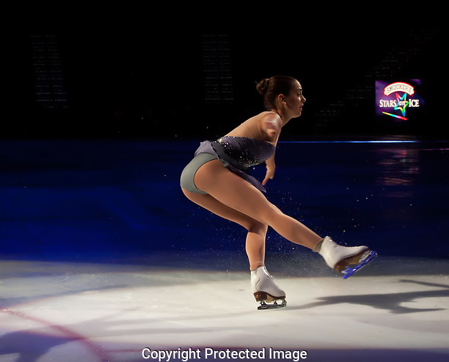 The Skater Recovers from Her Jump