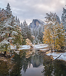 Yosemite National Park, California:<br /> Half Dome reflecting on the Merced river with fresh snow along the banks