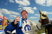 May 20, 2012; Topeka, KS, USA: NHRA pro stock driver Allen Johnson celebrates after winning the Summer Nationals at Heartland Park Topeka. Mandatory Credit: Mark J. Rebilas-