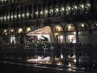 An orchestra plays amid Acqua Alta, Piazza San Marco, Venice