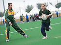 PUPILS FROM CORSTORPHINE PRIMARY ARE COACHED BY THE AUSTRALIANS AS THEY TAKE PART IN THE TOUCH WORLD CUP YOUTH FESTIVAL AT PEFFERMILL.